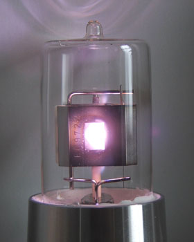 The apperture in the anode allows the light out.